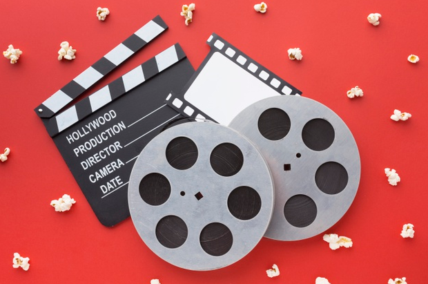 Image of movie elements in a red background.