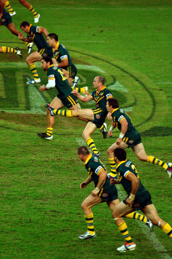 Rugby players running on the field