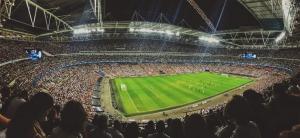 a huge soccer stadium full of spectators