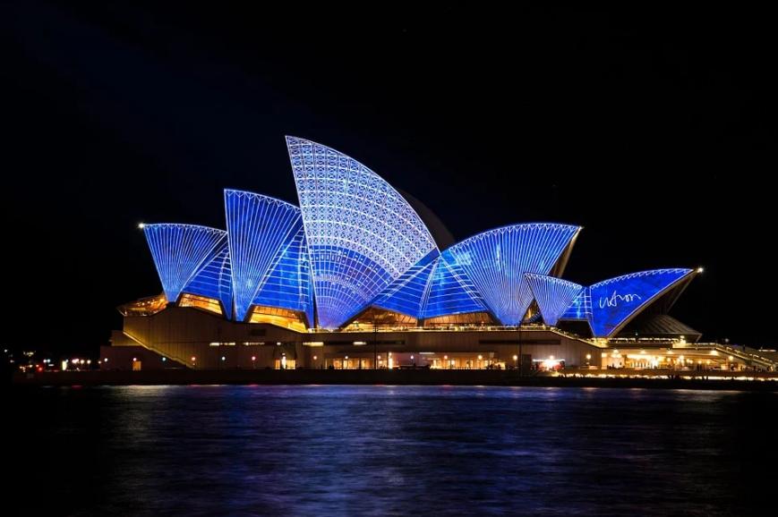 night sky, Sydney Opera House illuminated, water