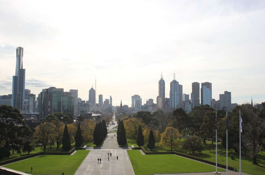trees, lawn, and skyscrapers in Melbourne