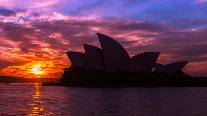 sunset, the silhouette of the Sydney Opera House, seawater, clouds