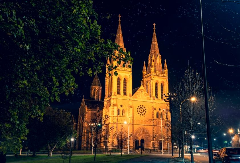 Illuminated twin spires of St Peters Cathedral in Adelaide.